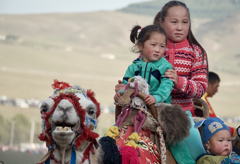 Nomadic girls on camels at the World Nomad Games in Kyrgyzstan